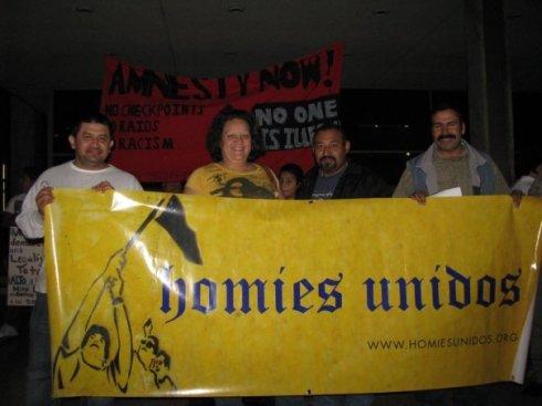 Luis Enrique Guzman at an Immigrant Rights Rally along with members of Homies Unidos