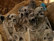 close-up-of-mass-grave-skeltons