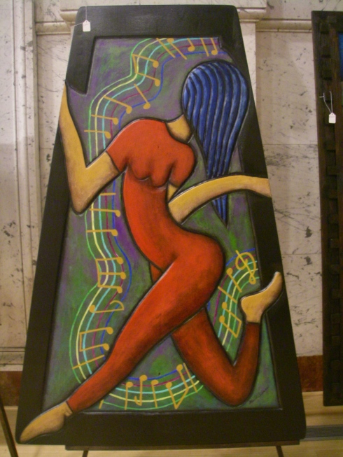 Dancing Women carved and painted onto Wood